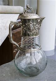 Sale 8205 - Lot 99 - An etched glass and EP claret jug with lion and shield finial, and bacchanalian spout, H 38cm