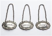 Sale 8528A - Lot 3 - A set of three George III sterling silver ornate bottle labels, heavy gauge, pierced and scalloped, Port, Sherry & Madeira, each L 6...