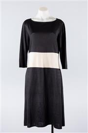 Sale 8760F - Lot 63 - A Salvatore Ferragamo knitted silk jersey dress in black and cream, size M