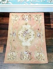 Sale 8577 - Lot 39 - An Aubusson style area rug in muted colours of coral pinks and beige, L 90 x W 60cm