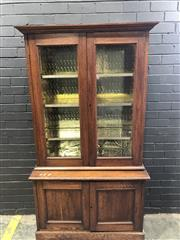 Sale 9014 - Lot 1052 - 1920s Oak Bookcase, with two glass panel doors above & two timber panels below (H:177 W:97 D:45cm)