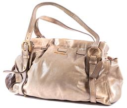 Sale 9132 - Lot 405 - A MIU MIU LEATHER SHOULDER BAG, soft grey leather with press stud closure and gathered top that ties at the side, gold tone hardware...