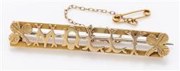 Sale 9180E - Lot 52 - An 18ct and 14ct two tone Milly name pin, with safety pin attachment, Length 5.5cm, weight 7.09g