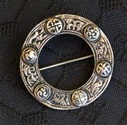 Sale 8259A - Lot 66 - A Sterling Silver Celtic Brooch, c1920, modelled in the round with a selection of raised bos, marked ...VER, d 38mm