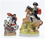 Sale 8873A - Lot 4 - Two Staffordshire figures of Napoleon crossing the Alps, a smaller and larger example
