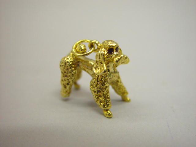 Sale 3545 - Lot 152 - A 9CT GOLD CHARM;
