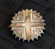 Sale 8259A - Lot 67 - A 19th Century Silvered Brooch, c 1880, modelled in the round with a central cross, and interspersed with raised hearts, d 38mm