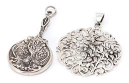 Sale 9182 - Lot 338 - TWO STERLING SILVER NOUVEAU STYLE PENDANTS; one fashioned as a miniature hand mirror, size 55 x 26mm, other round pierced floral des...