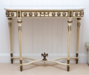 Sale 8677B - Lot 859 - A marble top console table in the French taste with porcelain roundels and ormolu mounts the stretcher base with urn finial H x 77cm...