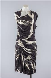 Sale 8760F - Lot 180 - An Emilio Pucci printed silk sleeveless dress in black and white, marked UK 16