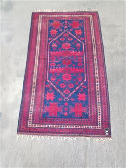 Sale 9255 - Lot 1324 - Red and blue Persian rug (200 x 115cm)