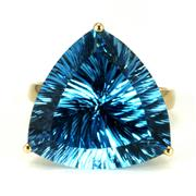 Sale 8315 - Lot 354 - A 14CT GOLD TOPAZ COCKTAIL RING; set with concave trilliant cut 19.88ct blue topaz, ring size O.