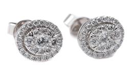 Sale 9168J - Lot 379 - A PAIR 10CT WHITE GOLD CREATED DIAMOND CLUSTER STUD EARRINGS; each of oval shape set with 29 round brilliant cut lab grown diamonds,...