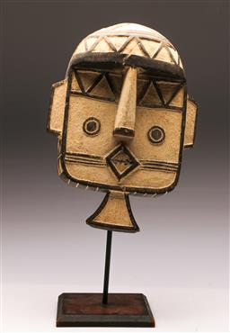 Sale 9131 - Lot 77 - Carved timber mask on stand (H:47cm)