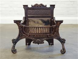 Sale 9179 - Lot 1032 - Edwardian Cast Iron Fire Grate, with scrolled back, grill front & leaf capped scroll legs - loose fitting (h:59 x w:55 x d:32cm)