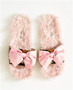 Sale 9095F - Lot 53 - A pair of Miu Miu fluffy slides with pink bow, size 36.5.