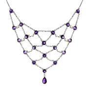 Sale 7995 - Lot 307 - A STERLING SILVER AMETHYST AND PEARL NECKLACE; 21 round cut amethysts rub set on silver mesh chain with seed pearls to a pear cut am...