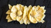 Sale 8259A - Lot 71 - A Carved Ivory Brooch, c 1920, modelled in the form of duel two overblown flowers