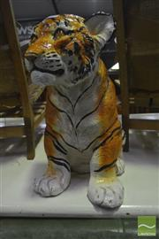 Sale 8284 - Lot 1071 - Ceramic Crouching Tiger (repair to face)