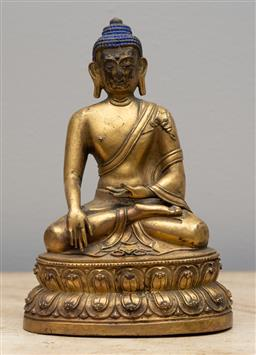 Sale 9160H - Lot 113 - A Tibetan gilt bronze buddha in earth touching position, with blue crown, Height 18cm x Width 12.5cm