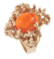 Sale 8946 - Lot 356 - A 14CT GOLD FIRE OPAL RING; featuring a 5 x 7mm cabochon fire opal set in an organic mount, size K, wt. 7.38g.