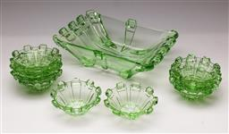 Sale 9119 - Lot 12 - Green depression glass centre dish W: 27cm, together with six small dessert bowls (dia: 12cm)