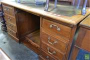 Sale 8520 - Lot 1031 - Edwardian Oak Office Desk, with Tooled Green Leather Top above a Centre Drawer and Pedestals fitted with Two Slides and Seven Drawers