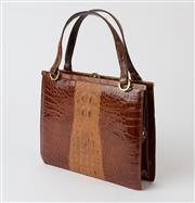 Sale 8550F - Lot 59 - A vintage two tone brown crocodile leather handbag with brass detailing, circa 1950s, W 65cm.