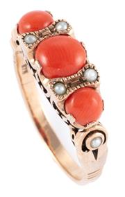 Sale 8954 - Lot 333 - A VICTORIAN STYLE CORAL AND PEARL RING; featuring 3 graduated coral beads set adjacent to 6 seed pearls on a carved gallery in 9ct g...