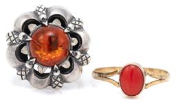 Sale 9090J - Lot 327 - VINTAGE SILVER AMBER AND CORAL RINGS; gilt ring set with an 8 x 6mm cabochon coral to split shoulders, size N, other claw set with a...