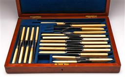 Sale 9144 - Lot 61 - A 19th century Manchester ivory handled knife carving suite in mahogany box (28 pieces), largest length 31cm