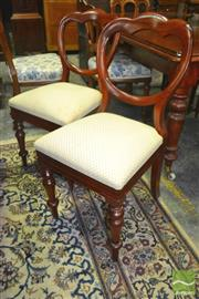 Sale 8267 - Lot 1029 - Set of Ten Victorian Mahogany Balloon Back Chairs with cream drop in seats