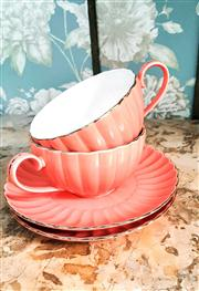 Sale 8577 - Lot 46 - A pair of vintage coral pink large cup & saucer set - Condition: Very Good - Measurements: Cup 13cm diameter x 7cm high / Saucer 21c...