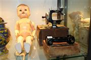 Sale 8276 - Lot 88 - Miniature Singer Sewing Machine In Case Together With A Pair Of Sandows Spring Dumbbells and A Doll