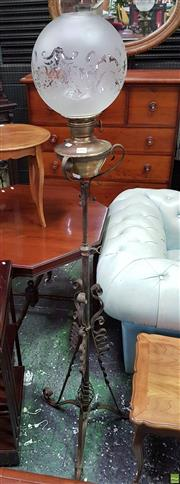 Sale 8559 - Lot 1016 - Brass Kerosene Floor Lamp with Famos Burner, having a frosted & etched ball shade, on wrought Iron tripod stand