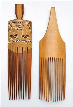 Sale 9144 - Lot 209 - An Early Papua New Guinea Sepik Lime Inlaid Incised Bamboo Wood Hair Comb, together with a timber example (L:26cm)