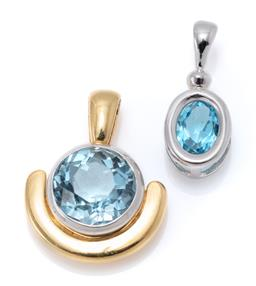 Sale 9168J - Lot 313 - TWO GOLD TOPAZ PENDANTS; an 18ct 2 tone set with an approx. 2.2ct round cut blue topaz, other in 9ct white gold set with an approx....
