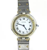 Sale 8447J - Lot 91 - A LADYS CARTIER SANTOS QUARTZ WRISTWATCH; in gold and stainless steel, white dial, Roman numerals, blued hands, sapphire crystal, c...