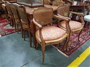 Sale 8831 - Lot 1081 - French Silky Oak Dining Table with Two Draw-Leaves together with a Set of Eight Ratan Back Chairs inc Two Carvers