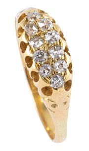 Sale 8974 - Lot 354 - A VICTORIAN DIAMOND RING; belcher set in 18ct gold with 10 Old Mine cut diamonds, size P, top measures 6.4 x 15.2mm, wt. 3.12g.