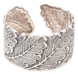 Sale 9132 - Lot 318 - A BUCCELLATI OAK LEAVES STERLING SILVER CUFF BANGLE; 34.5mm wide cuff with hinged terminal (missing spring), internal width 54mm,...