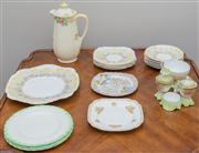 Sale 8470H - Lot 136 - A small group of Art Deco tea wares including a Royal Standard Daffodils pattern, Royal Doulton coffee pot, and a cruet set