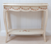 Sale 8677B - Lot 868 - A shabby chic rose painted, ivory coloured console table with lower shelf H x 76cm, W x 90cm, D x 70cm