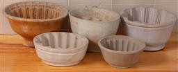 Sale 9120H - Lot 396 - A collection of jelly moulds, largest Width 20cm