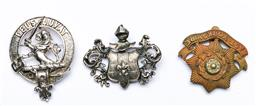 Sale 9144 - Lot 430 - Three British military badges to include knight example