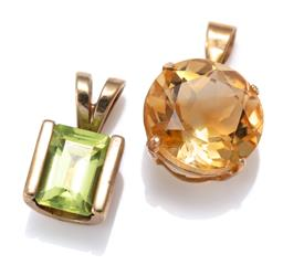 Sale 9168J - Lot 315 - TWO 9CT GOLD GEMSET PENDANTS; one set with an approx. 3.5ct round cut citrine, other with an emerald cut peridot of approx. 0.75ct,...