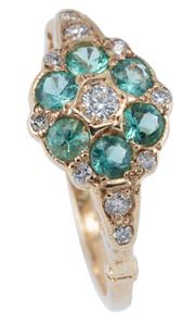 Sale 8974 - Lot 355 - A VINTAGE EMERALD AND DIAMOND CLUSTER RING; featuring a cluster of round brilliant cut diamonds and round cut emeralds to shoulders...
