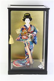 Sale 8796 - Lot 70 - cased geisha doll (54cm x 33cm x 29cm)