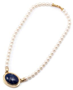 Sale 9132 - Lot 334 - A PEARL NECKLACE WITH 18CT GOLD DIAMOND AND LAPIS CENTERPIECE; faux pearl strand featuring an 18ct gold centerpiece rub set with a 3...
