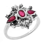 Sale 8060B - Lot 309 - A STERLING SILVER RUBY AND DIAMOND RING; set with an oval and pear shape rubies surrounded by single and flat cut diamonds. Size S.